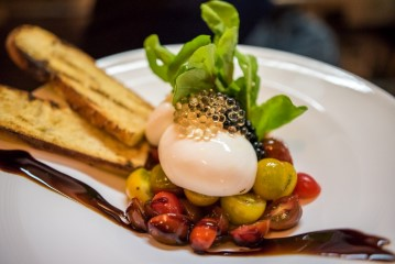 Burrata with spheres of black and white balsamic vinegar